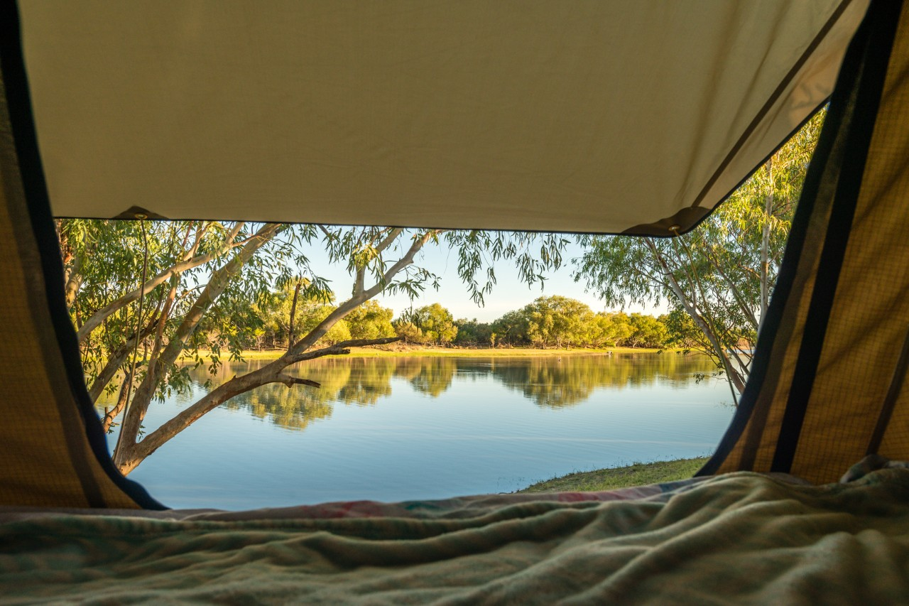 view from a tent overlooking a billabong in NT