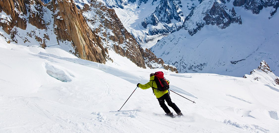 Male skier moving down in snow powder; envers du plan, vallèe blanche, Chamonix, Mont Blanc massif, France, Europe.