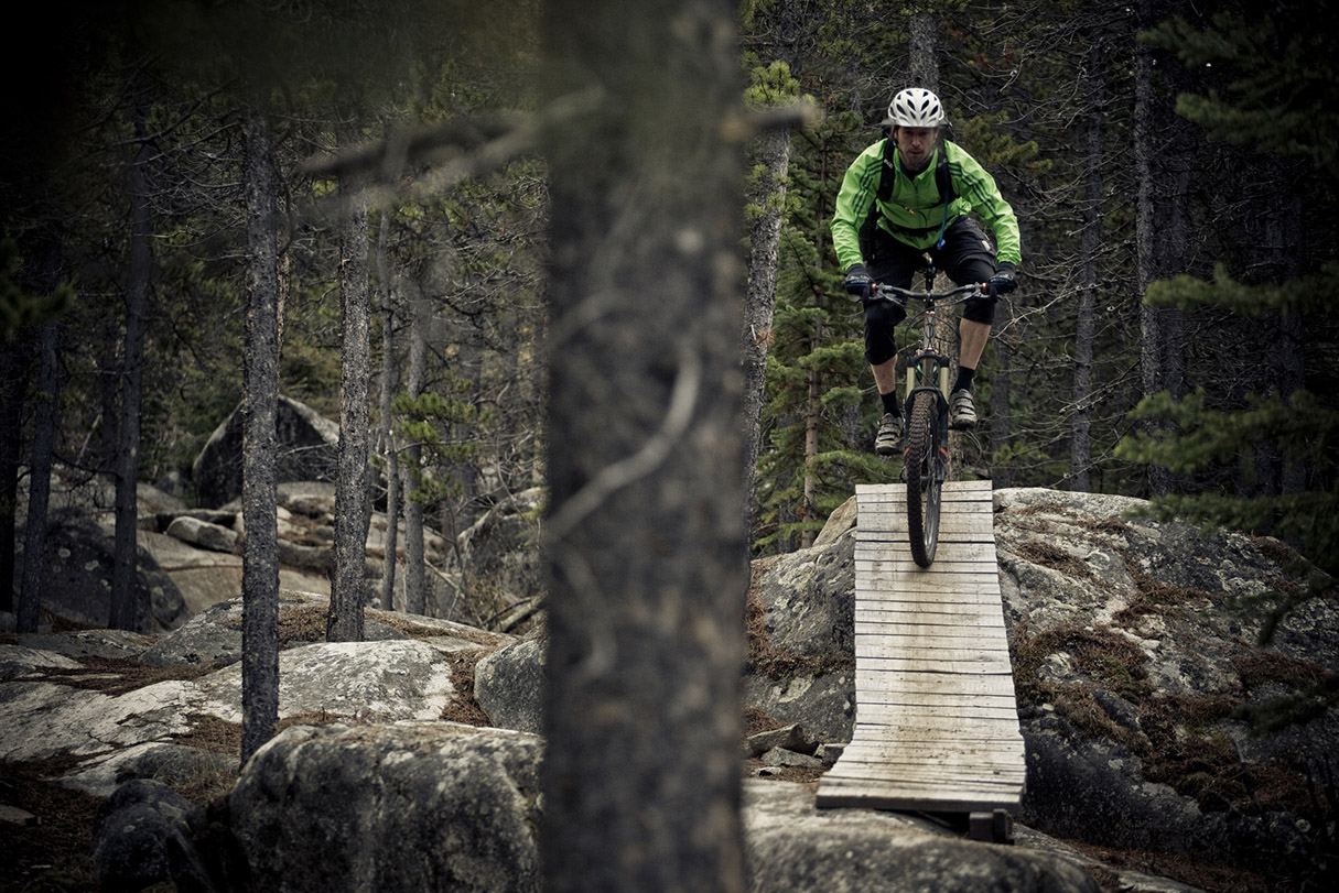 A male mountain biker rides the amazing trails of Carcross, Yukon during the fall colors.