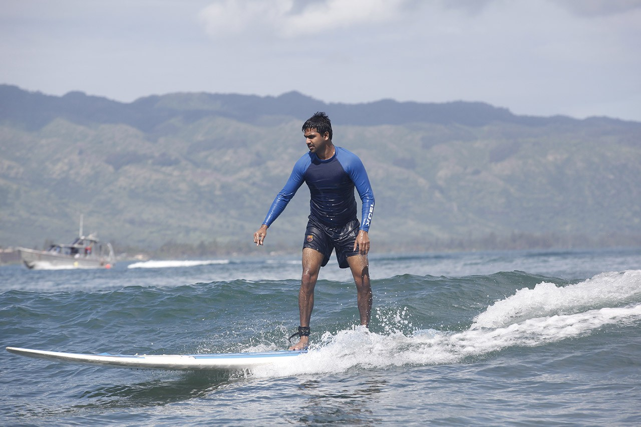 A student hangs 10 in Costa Rica's famous surf breaks
